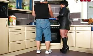 aroused cougar In Leather and Boots gets It In Kitchen
