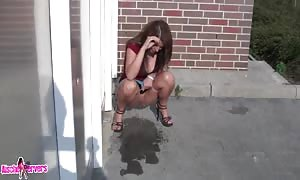 outdoor novice urinating and cock sucking by brown haired in red