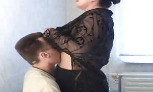 fatty Russian mom is having a horny sex with a slim stud