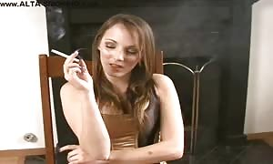 Smiling slut is smoking a cigarette in the video by Alta Smoking