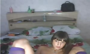 dark-haired Russian woman is playing with her stripped vag