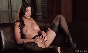 attractive dark haired Sunny Leone performs shocking solo masturbation