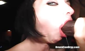 Cock-swallowing drunk babe is swallowing two stiff penises