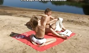 black-haired gobbles and penetrated on the beach