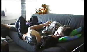 lovers on the couch gets it on lustily