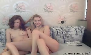Two playful big-chested Russian bombshells are posing completely