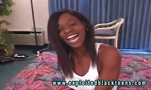 Smiling ebony lass takes a horny white cock in the main master bedroom