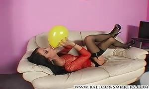 teenager looner popping balloons in fishnet top.